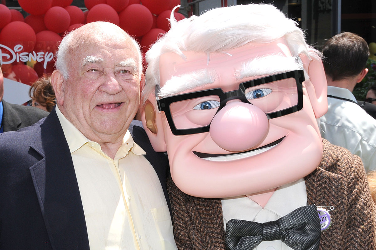 Ed Asner at the premier of Disney/Pixar's UP, standing next to a person dressed up as his character, Carl Fredrickson.