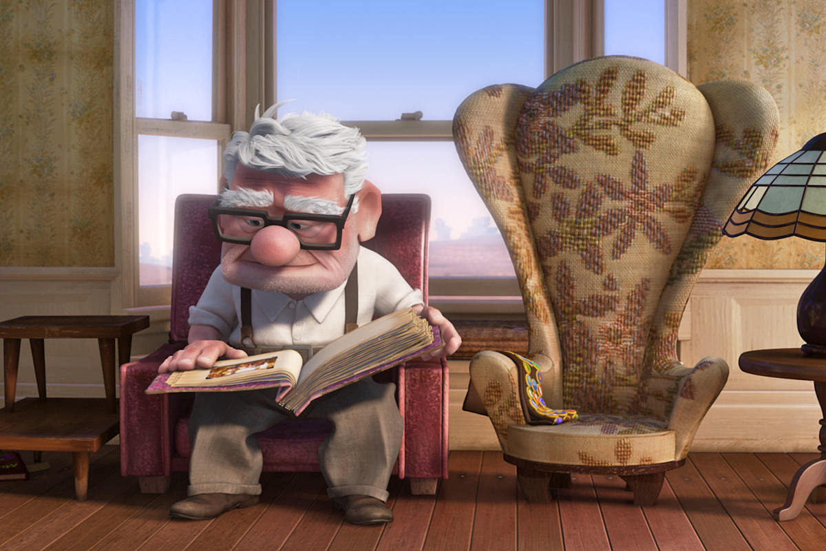 A still from the movie UP by Disney/Pixar showing an older Carl Fredrickson missing his wife.