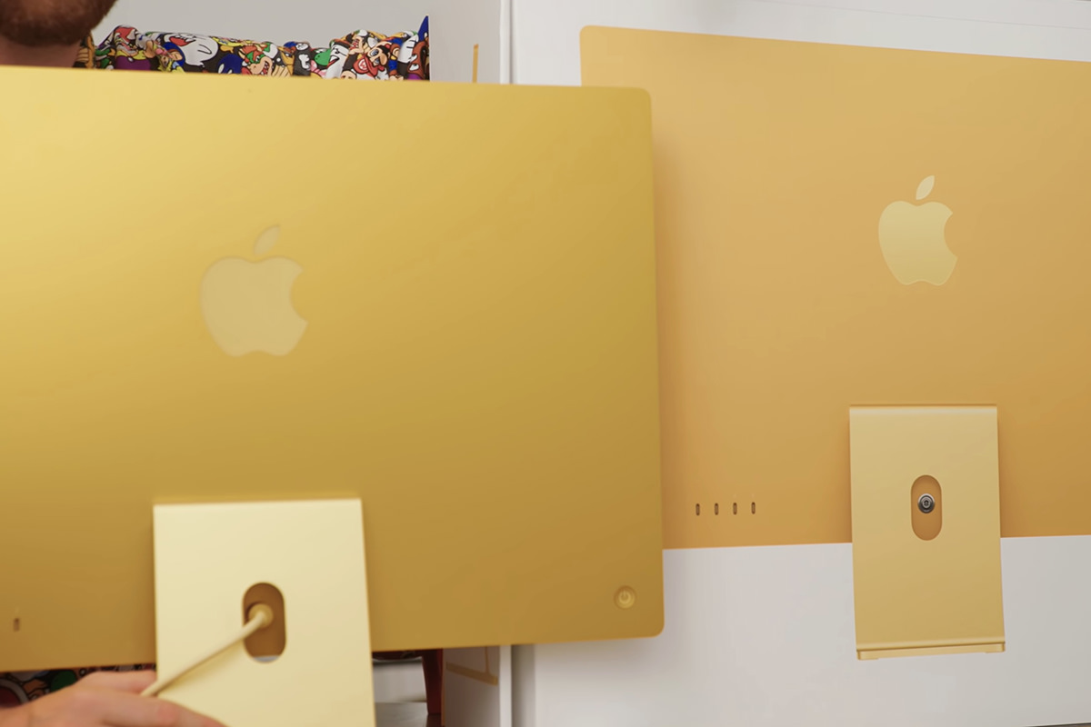 Comparing the gold iMac to the yellow iMac on the box.