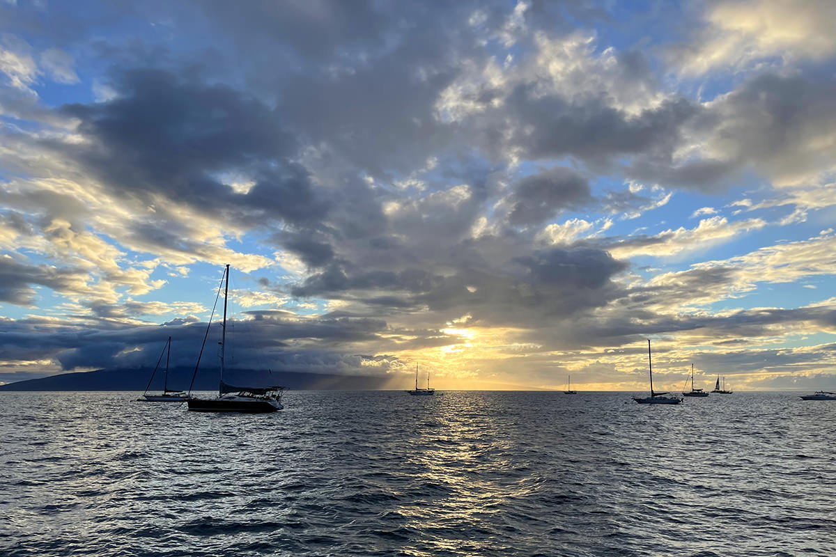 Boats off the coast of Lahaina as the sun sets.