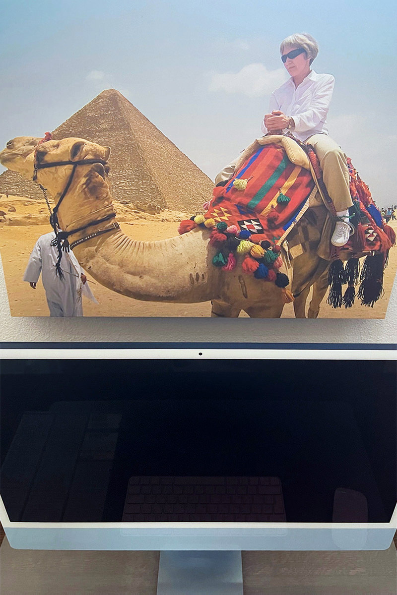 Looking down from a photo of my mom riding a camel at the pyramids of Egypt with my new iMac, Lemon, sitting below.