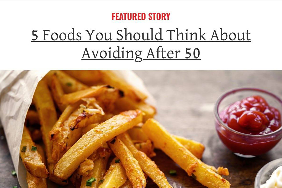 5 Foods You Should Think About Avoiding After 50: a photo of French fries with ketchup is showing.