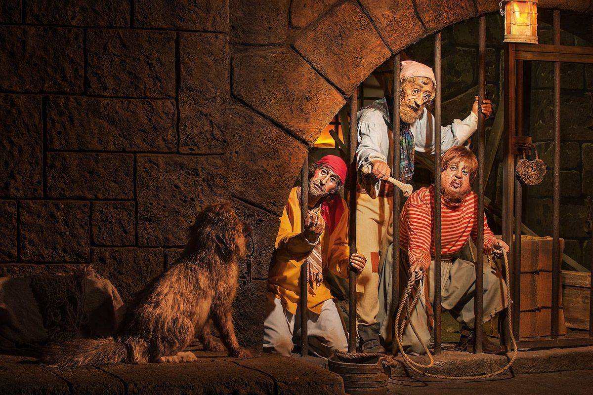 A scenes of prisoners trying to get a dog to give them the keys to their cell in the Pirates of the Caribbean ride at Disneyland.