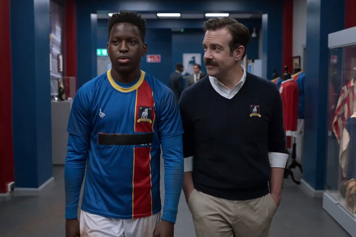 Sam walking through the locker room with Ted.