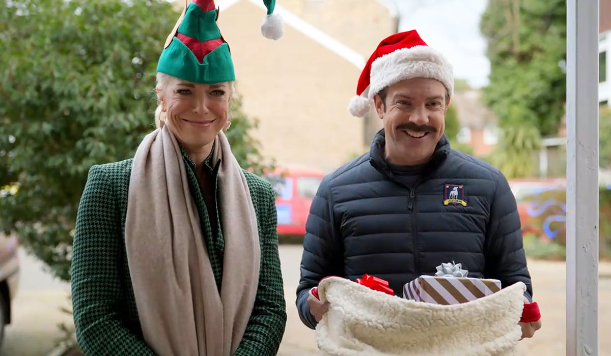 Rebecca and Ted are Santa's elves delivering gifts.