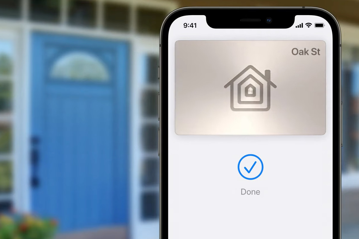 An iPhone wallet unlocking the door to a house.