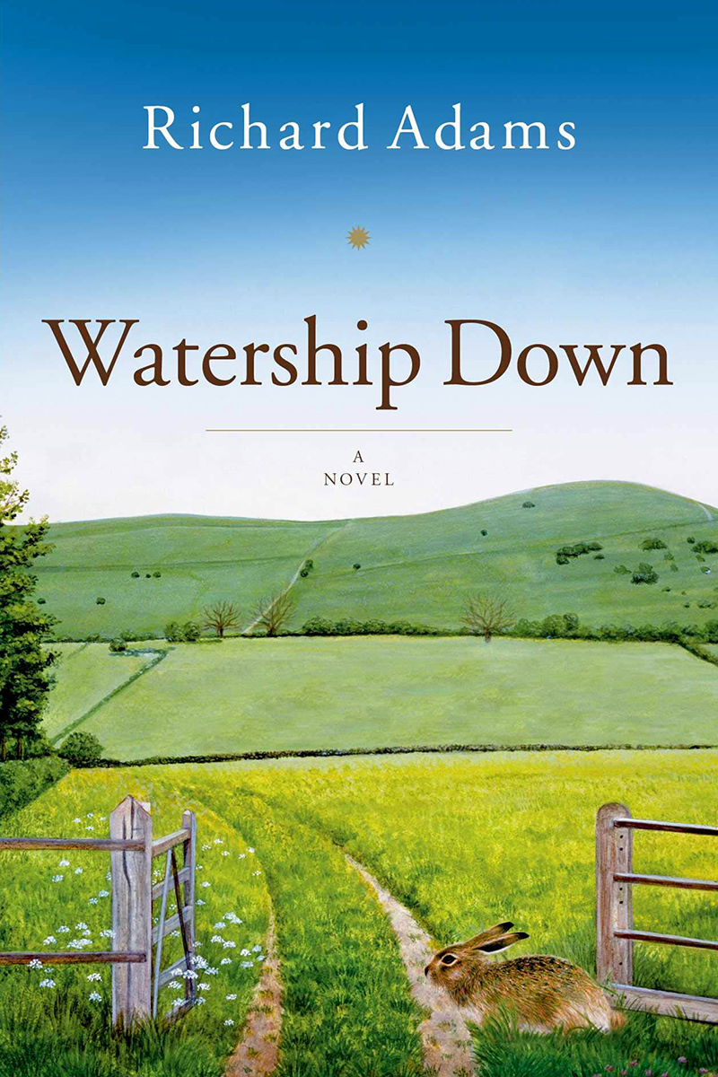 The cover of Watership Down, a novel, showing a bunny in front of a fence that borders a green, grassy field.